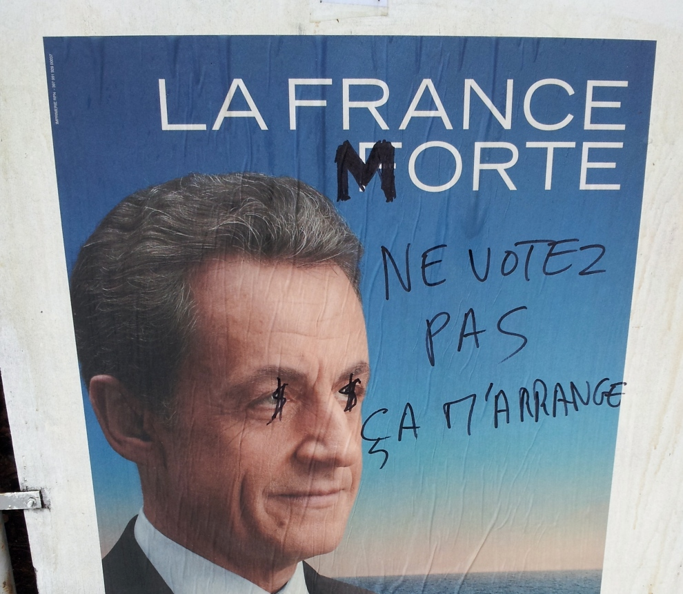 A campaign poster for French President Nicolas Sarkozy has an additional few flourishes added by a local graffiti artist in a rural village in SW France.